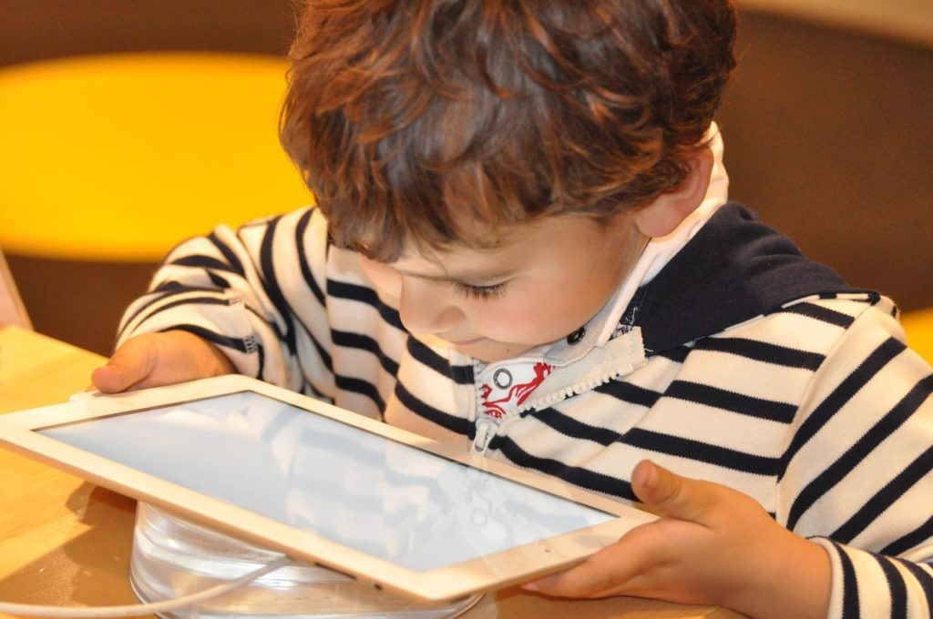 Child playing with an iPad