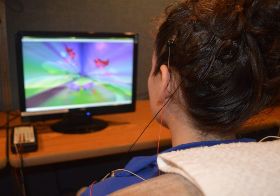 View over a client's shoulder while she does neurofeedback